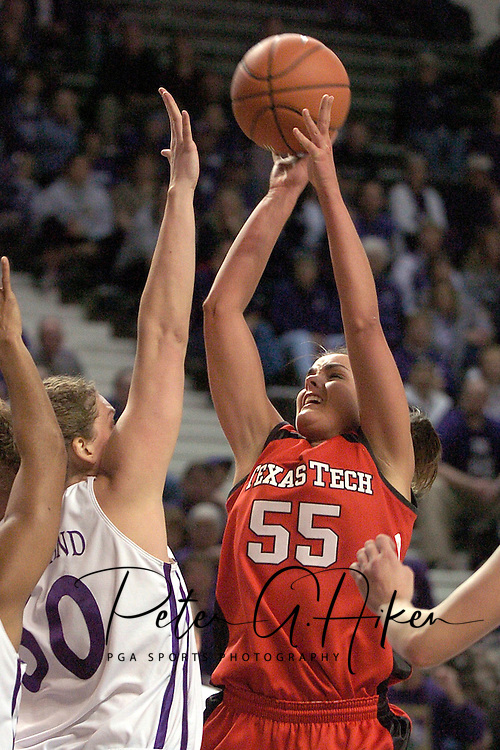Texas Tech forward Alesha Robertson (R) puts up a shot in the first half against pressure from Kansas State's Jessica McFarland (L), during K-State's 53-51 win over the Lady Raiders at Bramlage Coliseum in Manhattan, Kansas, January 4, 2006.