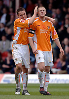 Photo: Daniel Hambury.<br />Brentford v Blackpool. Coca Cola League 1. 17/04/2006.<br />Blackpool's Peter Clarke is congratulated by Rory Prendergast after scoring a lte equaliser.