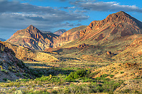 "The Chisos Mountains of West Texas is the southernmost mountain range in the United States, and is surrounded by the Chihuahuan Desert on the US-Mexico border. Located wholly within the borders of Big Bend National Park, this incredible view of this ancient volcanic mountain range was photographed on a late spring afternoon as the sun began to set in the ""golden hour""."