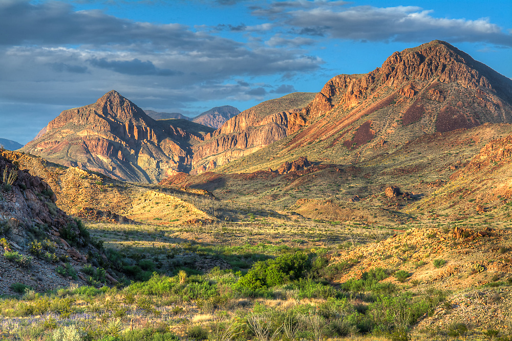 "The southernmost mountain range in the United States is the Chisos Mountains and are found in West Texas, completely surrounded by the Chihuahuan Desert. This ancient volcanic mountain range is found completely with the borders of Big Bend National Park along the US-Mexico border. This incredible view was photographed on a late spring afternoon as the sun began to set in the ""golden hour""."