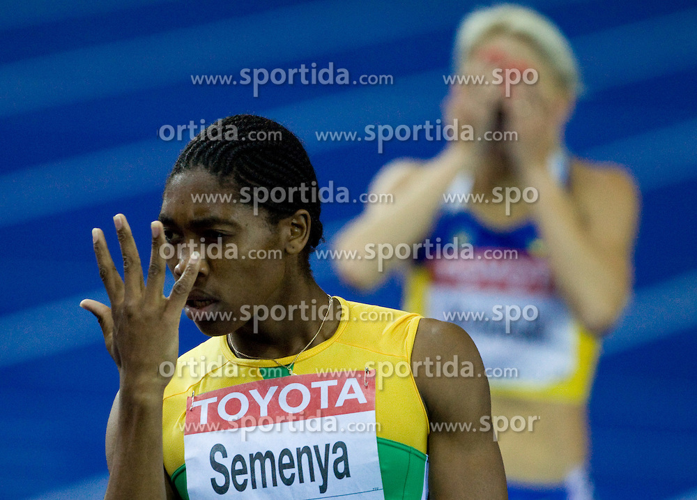 Caster Semenya of South Africa celebrates winning the gold medal in the women's 800 Metres Final during day five of the 12th IAAF World Athletics Championships at the Olympic Stadium on August 19, 2009 in Berlin, Germany. (Photo by Vid Ponikvar / Sportida)