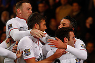 Robin van Persie of Manchester United (right) celebrates scoring the opening goal with team mates during the Barclays Premier League match at Selhurst Park, London<br /> Picture by David Horn/Focus Images Ltd +44 7545 970036<br /> 22/02/2014