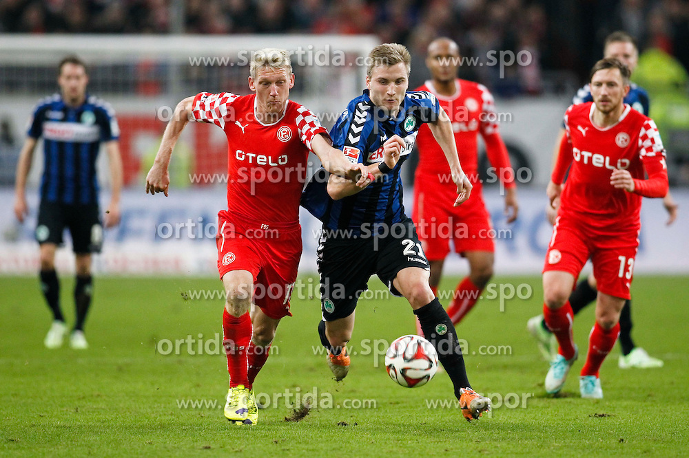 24.11.2014, Esprit-Arena, D&uuml;sseldorf, GER, 2. FBL, Fortuna D&uuml;sseldorf vs SpVgg Greuther F&uuml;rth, 14. Runde, im Bild Axel Bellinghausen (Fortuna Duesseldorf #11) im Zweikampf gegen Kacper Przybylko (SpVgg Greuther Fuerth #21) // during the2nd German Bundesliga 14th round match between Fortuna Duesseldorf and SpVgg Greuther Fuerth at the Esprit-Arena in D&uuml;sseldorf, Germany on 2014/11/24. EXPA Pictures &copy; 2014, PhotoCredit: EXPA/ Eibner-Pressefoto/ Schueler<br /> <br /> *****ATTENTION - OUT of GER*****
