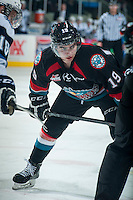 KELOWNA, CANADA - DECEMBER 3: Dillon Dube #19 of Kelowna Rockets faces off against the Saskatoon Blades on December 3, 2014 at Prospera Place in Kelowna, British Columbia, Canada.  (Photo by Marissa Baecker/Shoot the Breeze)  *** Local Caption *** Dillon Dube;