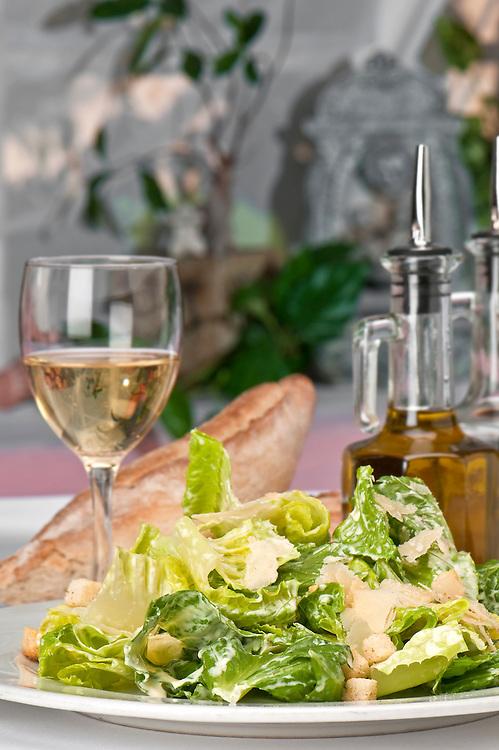 Traditional caesar salad with parmigiana crostoni.