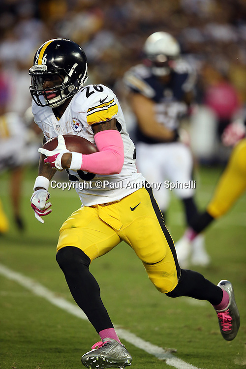 Pittsburgh Steelers running back Le'Veon Bell (26) runs for a second quarter gain of 10 yards and a first down during the 2015 NFL week 5 regular season football game against the San Diego Chargers on Monday, Oct. 12, 2015 in San Diego. The Steelers won the game 24-20. (©Paul Anthony Spinelli)