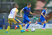 Ollie Rathbone brings the ball forward during the EFL Sky Bet League 1 match between Rochdale and Gillingham at Spotland, Rochdale, England on 15 September 2018.