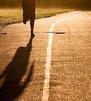 Runner on paved trail, early morning