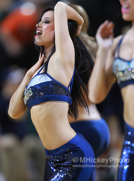 March 13, 2012; Indianapolis, IN, USA; An Indiana Pacers cheerleader performs on the court during a timeout at Bankers Life Fieldhouse. Indiana defeated Portland 92-75. Mandatory credit: Michael Hickey-US PRESSWIRE
