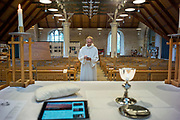 UNITED KINGDOM, London: 09 May 2020 <br /> Team Rector and Vicar of St Mary's Church in Barnes  Revd James Hutchings prepares to pre-record his Sunday service - the first service from inside the church (as opposed to his home) since the lockdown began. As of this week, clergy are now allowed to enter their churches to pray and stream/record services as part of the first of three stages to the re-opening of churches.