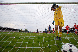 NEWPORT, WALES - Sunday, September 24, 2017: Gibraltar's goalkeeper Ethan Penfold picks the ball out of the net after Wales' fifth goal during an Under-16 International friendly match between Wales and Gibraltar at the Newport Stadium. (Pic by David Rawcliffe/Propaganda)