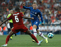 ISTANBUL, TURKEY - AUGUST 14: Ross Barkley (R) of Chelsea passes the ball as Georginio Wijnaldum of Liverpool defends during the UEFA Super Cup match between Liverpool and Chelsea at Vodafone Park on August 14, 2019 in Istanbul, Turkey. (Photo by MB Media/Getty Images)