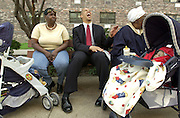 During his first run for office, Candidate for Newark Mayor Cory Booker sits on a bench in front of his home in a public housing complex called Brick Towers in 2002. He laughs with fellow residents Roberta Roberts, LEFT, and Aloma Marshall who are minding their grandchildren.  Booker sites his home as his favorite place in Newark because the residents have worked together to clean it up and make it a nice place to live.