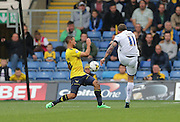 AFC Wimbledon midfielder Sean Rigg (11) shoots from range during the Sky Bet League 2 match between Oxford United and AFC Wimbledon at the Kassam Stadium, Oxford, England on 10 October 2015.