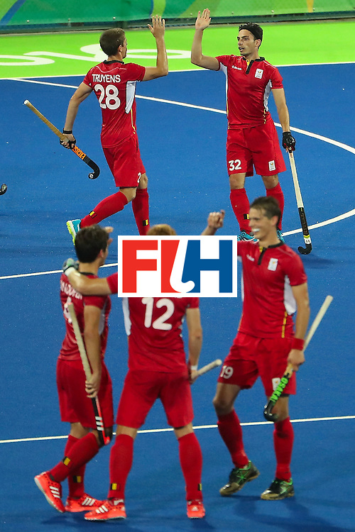 RIO DE JANEIRO, BRAZIL - AUGUST 09:  Tanguy Cosyns #32 (top right) of Belgium high fives Jerome Truyens #28 after scoring against Australia during the hockey game on Day 4 of the Rio 2016 Olympic Games at the Olympic Hockey Centre on August 9, 2016 in Rio de Janeiro, Brazil.  (Photo by Christian Petersen/Getty Images)