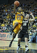 January 28, 2012: Iowa Hawkeyes guard Theairra Taylor (23) puts up a shot around Purdue Boilermakers guard Courtney Moses (15) during the NCAA women's basketball game between the Purdue Boilermakers and the Iowa Hawkeyes at Carver-Hawkeye Arena in Iowa City, Iowa on Saturday, January 28, 2012.