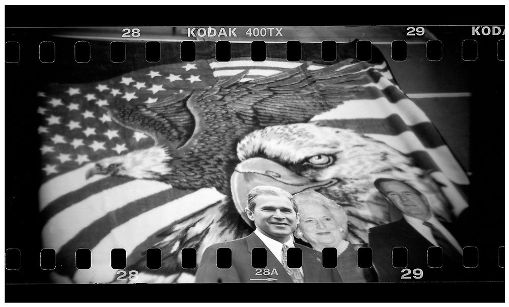 Cardboard cutout figures U.S. President George W. Bush (L), his mother Barbara Bush (C) and his father former President George H. W. Bush are see in front of a blanket on display at a souvenir shop in Crawford, Texas, December 13, 2008. The effect of the image was achieved by shooting 35mm black and white film in a medium format camera thereby exposing the entire negative including the sprocket holes of the film. REUTERS/Jim Young