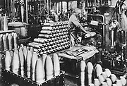 World War I 1914-1918: Forming shells in a German state munitions factory.  Armaments, Labour, Female