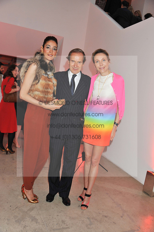 Left to right, YASMIN GHANDEHARI, SIMON DE PURY and MICHAELA NEUMEISTER at a dinner in aid The Journalism Foundation held at Philips De Pury & Company, Howick Place, London, SW1 on 22nd May 2012.