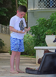 EXCLUSIVE: Kai Rooney takes a look at jewellery while on the beach in Barbados. 20 May 2018 Pictured: Kai Rooney. Photo credit: MEGA TheMegaAgency.com +1 888 505 6342