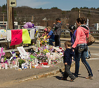 Memorial at Messer Street bridge in Laconia following a tragic vehicle accident last week.  Karen Bobotas/for the Laconia Daily Sun