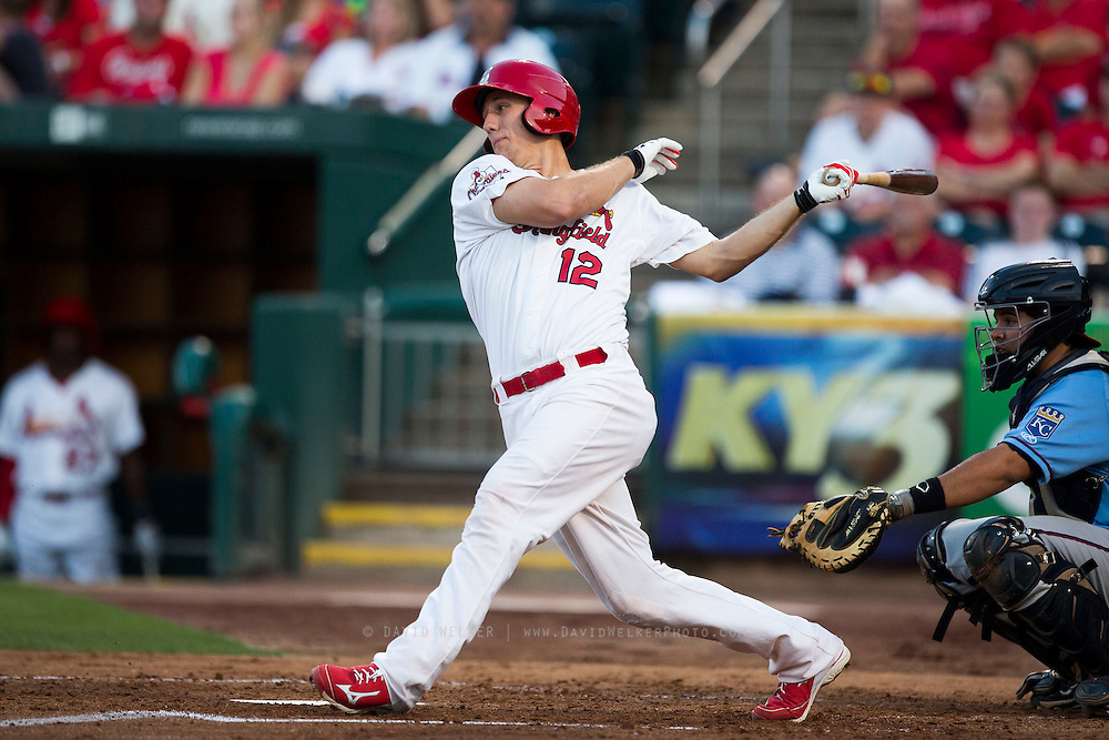 Stephen Piscotty (12) of the Springfield Cardinals follows through his swing after making contact on a pitch during a game against the Northwest Arkansas Naturals at Hammons Field on August 23, 2013 in Springfield, Missouri. (David Welker)