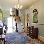 CREAM RIDGE, NJ - OCTOBER 29, 2016: The first floor foyer has a mural of the property, doors to the double parlor, library and dining room. A doorway at the far end leads to a full bath and a mudroom exit to the backyard. 92 Holmes Mill Rd, Cream Ridge, NJ. Credit: Albert Yee for the New York Times