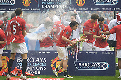 WIGAN, ENGLAND - Sunday, May 11, 2008: Manchester United's Rio Ferdinand and Owen Hargreaves celebrate after winning the Premier League for the 10th time after the final Premiership match of the season at the JJB Stadium. (Photo by David Rawcliffe/Propaganda)