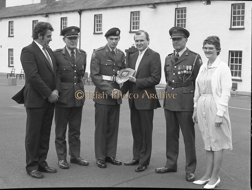 Army Apprentice Graduation Ceremony..1986..03.07.1986..07.03.1986..3rd July 1986..54 army apprentices graduated as tradesmen after completing three years of both military and technical training at the Army Apprentice School, Naas. The school is part of Devoy Military Barracks. The following trades are catered for: Radio Mechanic,Carpenter,Fitter, Electrician and Armourer..The newly graduated tradesmen will complete their basic military training at St Stephen's Barracks ,Kilkenny, for a further eight weeks..Mr John Witherington,Managing Director,Irish Shell, presented the awards...Picture of Mr John Witherington,Managing Director,Irish Shell,presenting Apprentice John O'Connor with the award for Best Soldier in the platoon.incleded in the picture (L-R) were.Patrick O'Connor, Brig.Gen.Charles McGuinn,GOC Curragh Command,Lt. Col. Fintan Mollowney,OC Army apprentice School and Mrs Elizabeth O'Connor. Mr and Mrs O'Connor hail from Toureen,Burnfoot,Mallow,Co.Cork.