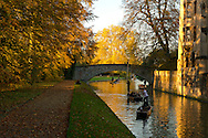 Golden light and punts on the Cam on an autumn day in Cambridge, UK