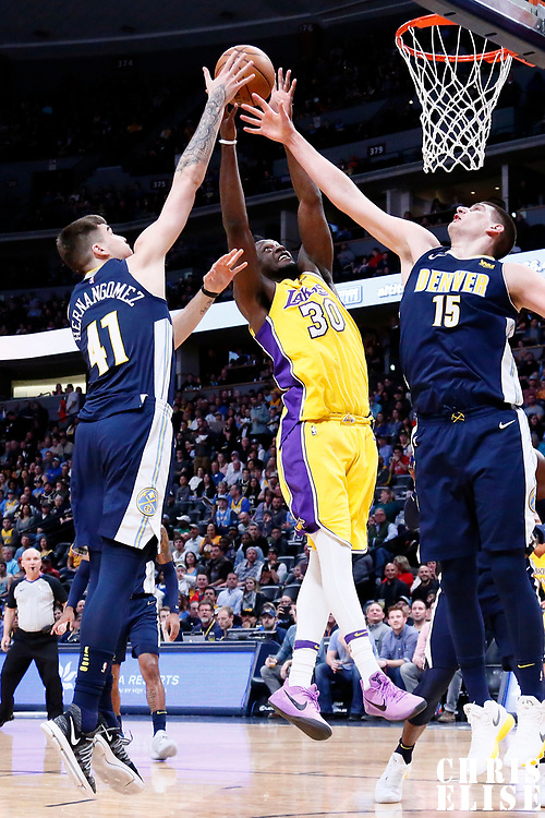 09 March 2018: Los Angeles Lakers forward Julius Randle (30) vies for the rebound with Denver Nuggets forward Juan Hernangomez (41) and Denver Nuggets center Nikola Jokic (15) during the Denver Nuggets125-116 victory over the Los Angeles Lakers, at the Pepsi Center, Denver, Colorado, USA.