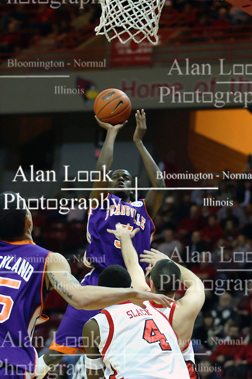 30 January 2007: Shy Ely shooting over Brandon Holtz and Anthony Slack.. The Purple Aces of Evansville folded the final 2 minutes of play and handed the game to Illinois State University Redbirds by a score of 65-61at Redbird Arena in Normal Illinois.