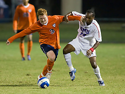 Virginia Cavaliers midfielder/defender Matt Poole (3) and Southern Methodist Mustangs forward/midfielder Dane Saintus (10) battle for the ball. The #18 ranked Virginia Cavaliers fell to the #14 ranked Southern Methodist Mustangs 3-1 in NCAA men's soccer at Klockner Stadium on the Grounds of the University of Virginia in Charlottesville, VA on August 31, 2008.