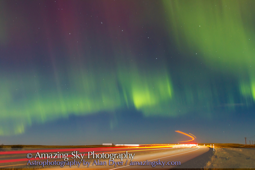 Aurora over Highway 1, the Trans-Canada Highway, west of Brooks, Alberta, on Sept 30, 2012. This is looking north to the Big Dipper. This is a composite of two 10-second exposures at ISO 400 with the Canon 7D and 24mm lens at f/2.8. A second exposure layered in adds in additional trails from the tailights, but the sky is from a sinngle exposure.