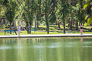 Men Fly Fishing at Ralph B. Clark Regional Park in Buena Park