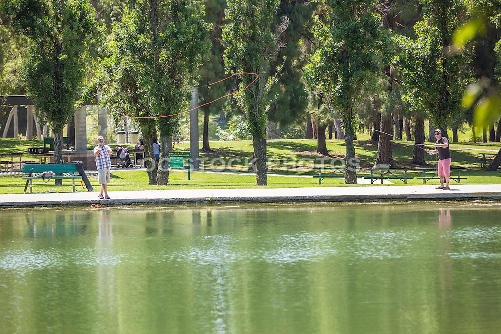 Men Fly Fishing at Ralph B. Clark Regional Park in Buena Park