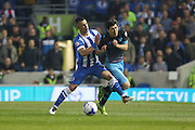 Brighton central midfielder, Beram Kayal (7) tackles Sheffield Wednesday striker Fernando Forestieri (45) during the Sky Bet Championship play-off second leg match between Brighton and Hove Albion and Sheffield Wednesday at the American Express Community Stadium, Brighton and Hove, England on 16 May 2016. Photo by Phil Duncan.