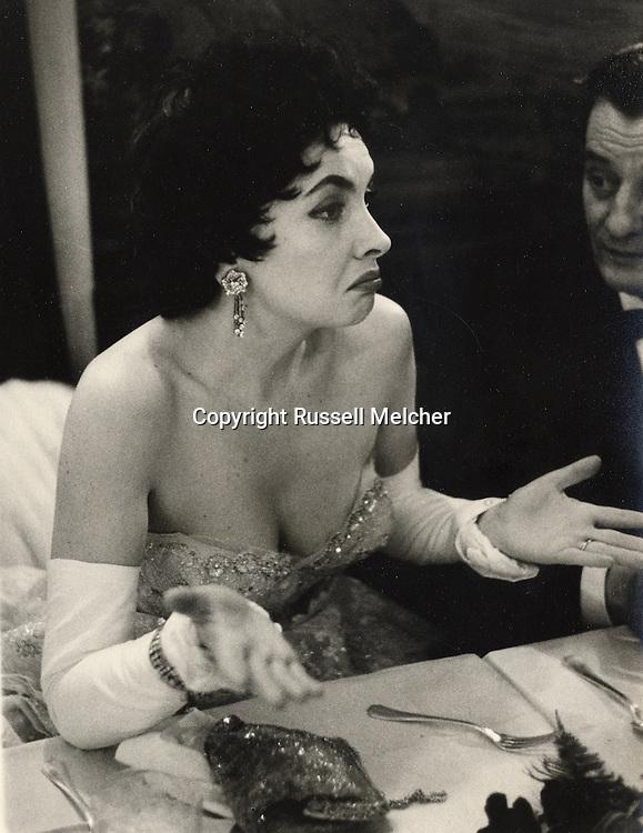Paris.1956.Gina Lollobrigida in a heated discussion during a gala night for the film Trapeze.<br /> <br /> <br /> Paris.1956.Gina Lollobrigida durant une discussion anim&eacute;e au cours d'une soir&eacute;e de gala pour le film Trapeze.
