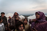 Abu and Um Ghaith, centre and right, with some of their children in Atmeh camp in north western Syria. The camp currently holds more than 12,000 displaced people from across Syria. 02/01/2013