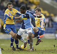 Photo: Aidan Ellis.<br /> Mansfield Town v Wycombe Wanderers. Coca Cola League 2. 24/02/2007.<br /> Wycombe's Matt Bloomfield (C) is challenged by Mansfield's Gareth Jelleyman (L) and Bryan Hodge