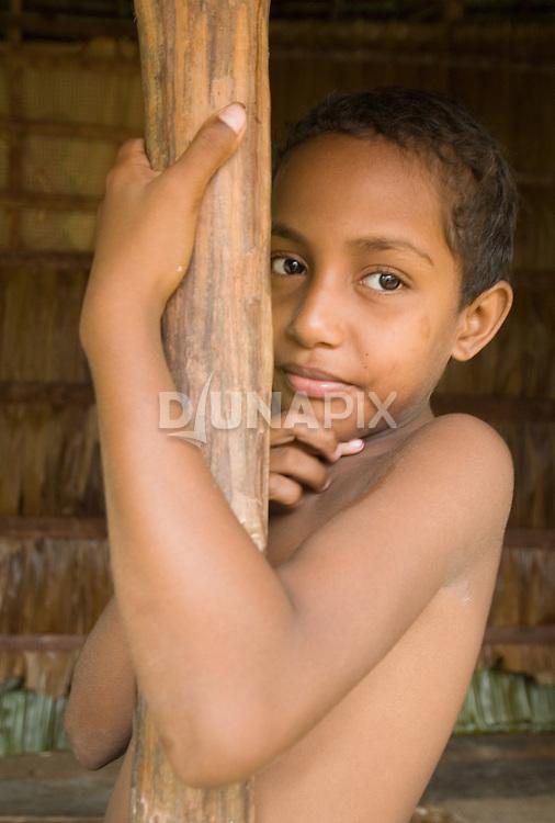 Portrait of a boy at a betel net farm, Waghena.