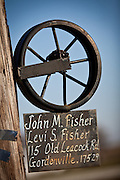 Amish family sign showing a wheel in Gordonville, PA.