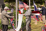 Descendants of Civil War soldiers retire the flag at a ceremony marking Confederate Memorial Day at Magnolia Cemetery April 10, 2014 in Charleston, SC. Confederate Memorial Day honors the approximately 258,000 Confederate soldiers that died in the American Civil War.