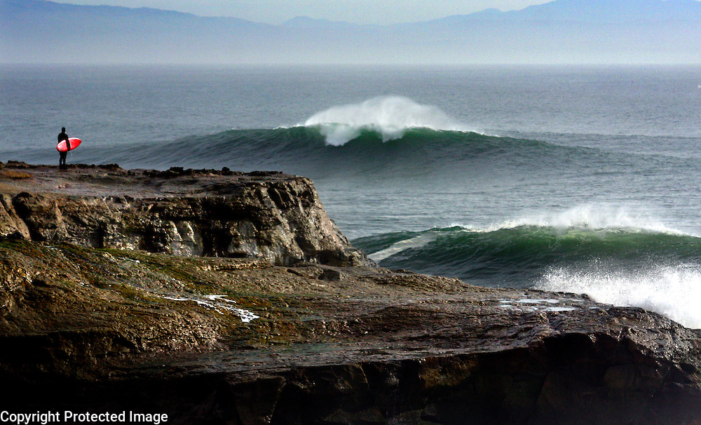 A big swell pours past Lighthouse Point into Steamer Lane and Its Beach in Santa Cruz, California on Sunday January 10, 2010.<br /> Photograph by Shmuel Thaler/Santa Cruz Sentinel
