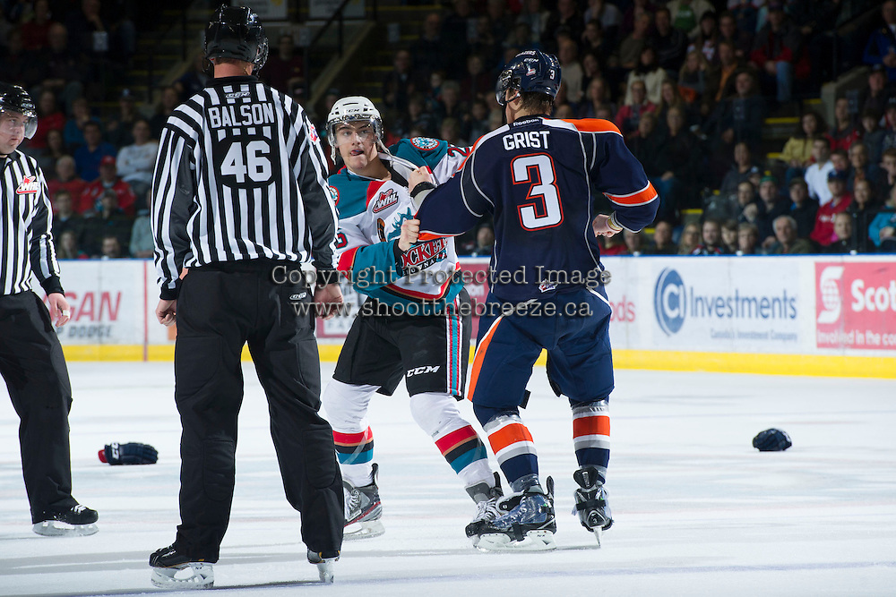 KELOWNA, CANADA - DECEMBER 27:  Sam Grist #3 of the Kamloops Blazers drops the gloves with Colton Heffley #25 of the Kelowna Rockets at the Kelowna Rockets on December 27, 2012 at Prospera Place in Kelowna, British Columbia, Canada (Photo by Marissa Baecker/Shoot the Breeze) *** Local Caption ***