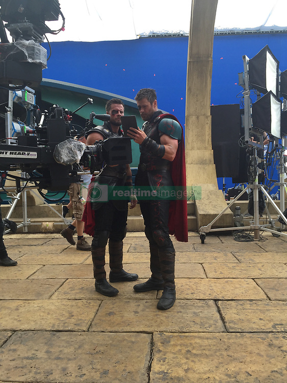"""EXCLUSIVE: WEB EMBARGO UNTIL 1am PST ON Nov 3 Chris Hemsworth's stunt double has given an exclusive behind the scenes look at his time on the set of Thor: Ragnarok to coincide with the release of the Marvel blockbuster. Opening up his personal photo diary taken while on location in Australia's Gold Coast, British-born stunt master Bobby Holland Hanton talks long days on set with Hemsworth and how he's become the Aussie star's go-to stuntman and good friend having worked together for the past six years. Bobby, 33, also revealed one of his rigorous training sessions at his local London gym — where the former gymnast put on an impressive stunt routine including back flips and somersaults — before he headed out to Atlanta in September to start filming the fourth Avengers movie, where he will again double for Hemsworth as Thor. And judging by Bobby's rippling six-pack and bulging biceps, the rigorous regime he has to endure to match up to the God Of Thunder has paid off. But by his own admission, keeping up with 34-year-old Chris is no easy feat. Bobby explained: """"He's in ridiculous shape - Chris is very athletic and naturally has a lot of lean muscle mass. He's bigger than me and I have to work hard to keep up with him. """"Before we start filming a movie together, we're in touch regularly so I can see where he's at and so I can maintain the same shape as him."""" Bobby's strict fitness plan includes working out twice a day, six days a week for between 45 minutes to 90 minutes, curling 27kg dumbbells to pump up his arms and eating eight monster-size meal every day. Of course, the types of foods he can eat are strictly regulated to those that are high in protein (lots of chicken, turkey, steaks and eggs) and only """"good carbs"""" (brown rice, quinoa, sweet potatoes) and """"good fats"""" (avocado, olive oil and natural nuts). And eating like Thor sure gives his wallet a bit of a hammering. """"I spend around £250 a week on food, just for me"""" expla"""