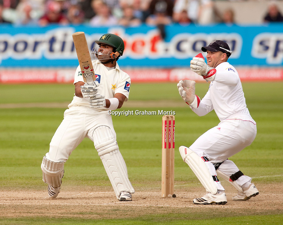 Wicket keeper Matt Prior watches as Umar Akmal pulls Graeme Swann to the boundary during the third npower Test Match between England and Pakistan at the Oval.  Photo: Graham Morris (Tel: +44(0)20 8969 4192 Email: sales@cricketpix.com) 19/08/10