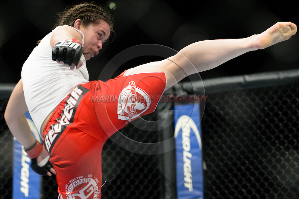 "MANCHESTER, ENGLAND, OCTOBER 26, 2013: Rosi Sexton throws a kick during ""UFC Fight Night 30: Machida vs. Munoz"" inside Phones4U Arena in Manchester, England (© Martin McNeil)"