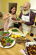 "Alternative medicine advisor and integrative medicine practitioner, Dr. Andrew Weil, right, and Rosie Daley, former personal chef for Oprah Winfrey, prepare a meal in Weil's home in Vail, Arizona, USA. The two have collaborated on a book, ""The Healthy Kitchen Recipes For A Better Body, Life, and Spirit."""