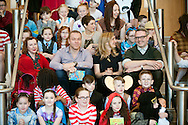 L-R Lydia Monks, Sir Chris Hoy,Joanna Nadin, Cressida Cowell, Rob Biddulph sit with pupils from Saint Rose of Lima primary school as part of the Biggest Book Show on Earth at the Glasgow Royal Concert Hall. 27/02/2017.<br /> <br /> The Biggest Book Show on Earth is organised by World Book Day UK as part of the annual celebration of books and reading. This year the roadshow will visit Glasgow, Coventry, Barry, London and Dublin with an all-star line-up of over 30 authors and illustrators, giving over 6,000 children the opportunity to see their literary heroes in person. Around 2,000 local primary school children will attend the Glasgow event at the Royal Concert Hall.